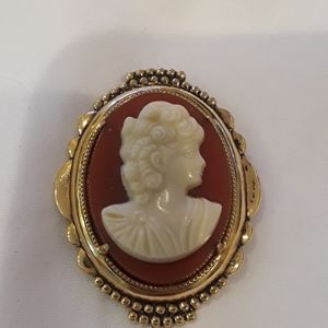 Beautiful gold plated cameo.